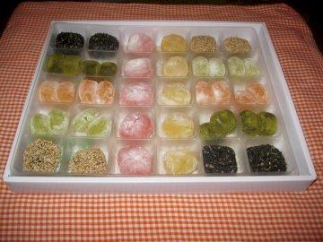 MOCHI JAPANESE SWEETS - Mochi - Japanese rice sweets. Mochi is pronounced like MOCI. A tray of food.