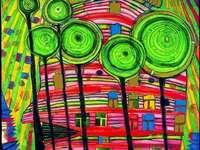 HUNDERTWASSER - HUNDERTWASSEUR. HUNDERTWASSER maternelle. Un gros plan d'un mur coloré. HUNDERTWASSEUR-MATERNE