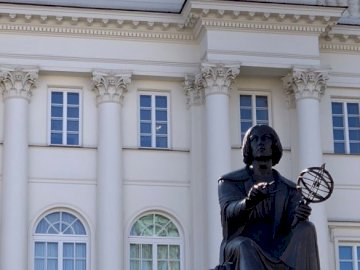 Warsaw - Polish Academy of Sciences and the Nicolaus Copernicus Monument. A statue in front of a building.