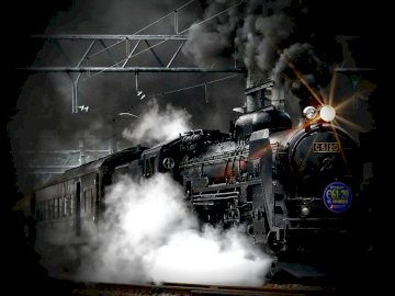 steam train - Dark passenger train going to hell;). A steam engine on a train track with smoke coming out of it.