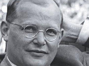 Bonhoeffer - Puzzle by Dietrich Bonhoeffer. Dietrich Bonhoeffer wearing glasses and looking at the camera.