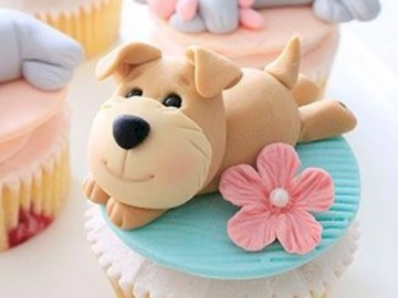 magdalenas - te gustan los cupcakes prefieres perros. Un grupo de peluches sentado sobre una mesa.