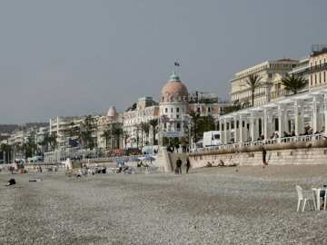 Azure coast - vacation on the French Riviera. A group of people walking in front of a building.