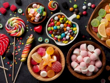 sweets - eating candy lollipops. A bunch of food on a table.