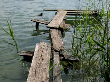 Bridge over the lake - Bridge over the Polish lake. A wooden bench sitting next to a body of water.