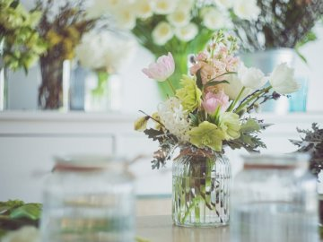 Lovely flower arrangement in - Pink and white flowers in clear glass vase. Bucharest, Romania. A bouquet of flowers in a vase on a