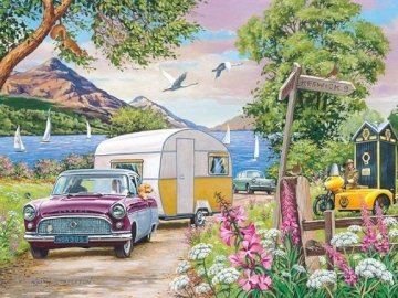 On vacation. - On vacation with a caravan. A car parked in the grass.