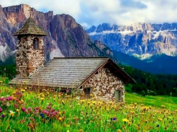 Small Church In The Mountains - Small Church In The Mountains, Alps. A large green field with a mountain in the background.