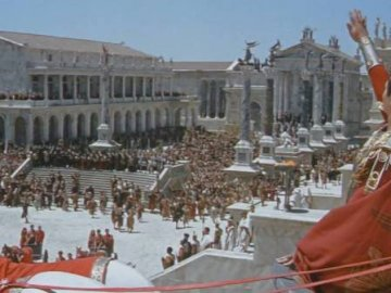 ROMAN EMPIRE - GOVERNMENT OF THE ROMAN EMPIRE. A group of people standing in front of a building.