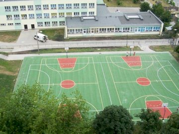 Our school - Photo of our school - j. A close up of a basketball game.