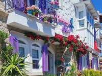 A house with shutters. - A house with lavender shutters. A group of people walking in front of a building.