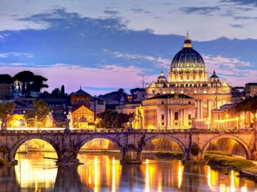 Rome panorama - A beautiful panorama of Rome - Italy. St. Peter's Basilica over water in front of a building.