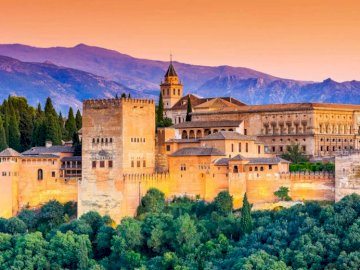 The Alhambra - Alhambra - the greatest monuments of Andalusia. A castle like building with Alhambra in the backgrou