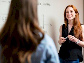 Female software engineer in - Woman in black sleeveless top.