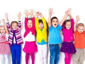 All children are ours -  Arrange puzzles with children. A group of people posing for a photo. All Our Children are