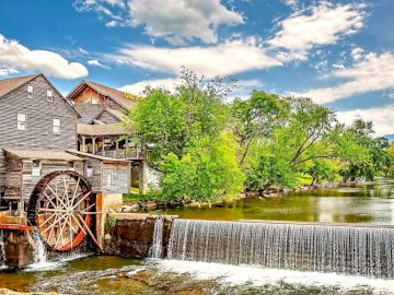 Watermill - water mill in the center of a quiet forest