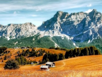 Dolomites - mountain landscape ---------------. A canyon with a mountain in the background.