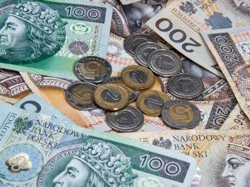 Pieniądze - Ilustracja z banknotami i monetami.