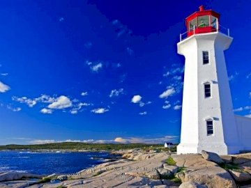 Peggy Cove Lighthouse Nova Scotia Canada - Photo of the famous Peggy's Cove Lighthouse in Nova Scotia, Canada surrounded by the picturesqu