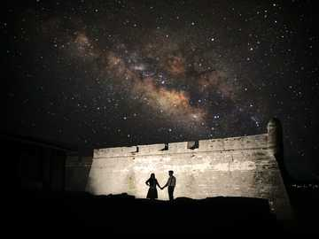 Lovers under the night sky. - silhouette photography of man and woman. Saint Augustine, FL, USA
