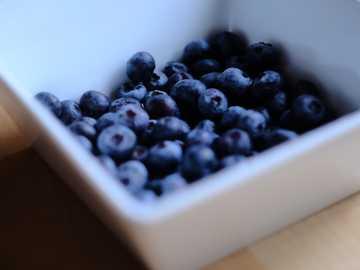 Blueberries. simple, fresh. - black berries in white ceramic bowl.