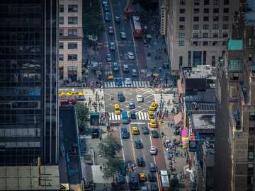Crossing - aerial photography of parked vehicle between buildings. New York, United States