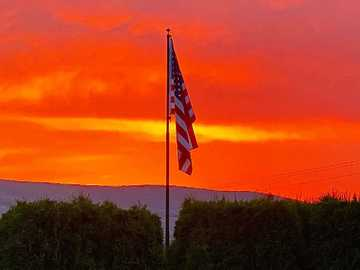 sunset with American flag - USA Flag at sunset with mountains