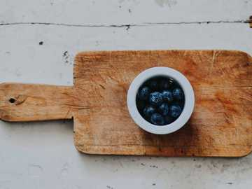 blueberries on white saucer on chopping board - Cause without them Nutella is just pure diabetes.