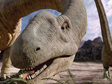 Dinosaur eating very nice - Argentinosaurus huinculenesis feeds on fresh leaves.