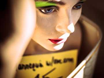 Mannequin - woman with green eyeshadow and red lipstick. San Francisco, United States