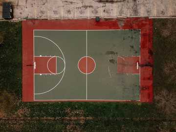 Basketball Court - red and white basketball court.