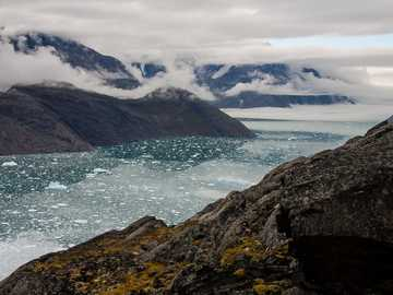 sea clouds and mountains - This photo was shot at «Mellem Landet» in greenland - quite a remote place. We were 3 hiking from