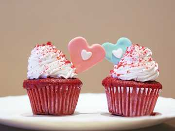 Celebrating Love. - 2 cupcakes with white icing on top. Utsav - Gourmet Cakes And Breads, Netaji Subhash Place, Wazirpur