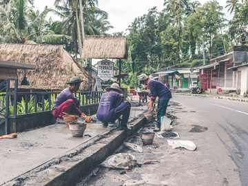 three men constructing road during daytime - Your donations will help me invest in a new lens. Check a link to my full story in bio. Bali, Indone
