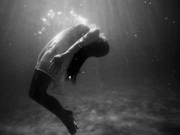 woman underwater in dress - grayscale photo of woman drowning in water. Tallebudgera Creek, Australia