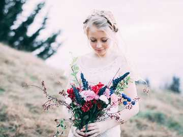 taylorjamesphotos Kali Lu Wedding - girl holding assorted bouquet flowers while looking down. Maple Valley, United States