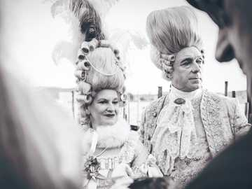 aristocrat costumes San Marco - black and white photography of man and woman in costume. San Marco, Venice, Italy