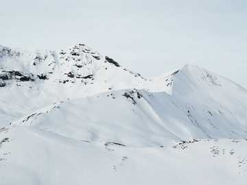 snow covered mountain during daytime - The view of adjacent mountains from the slopes of Vorab. Laax, Switzerland