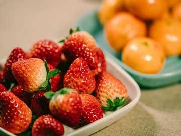 strawberry and orange fruits in bowl - Strawberry season-winter fruit gourmet. Wuxi, Jiangsu, China