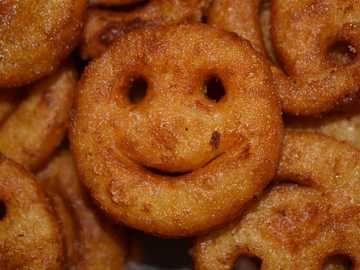 Potato smiley - brown cookies in close up photography.