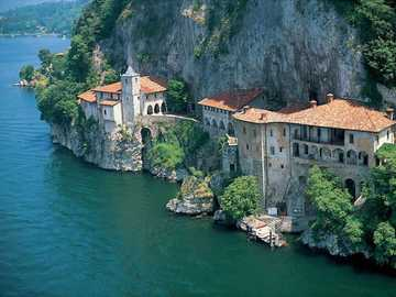 Lugano in Switzerland - Beautiful houses carved in the steep rock by the lake