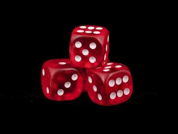 three red dice - Four Dice. A tribute to chance. We accept a certain amount of risk in life for the possibility of wi