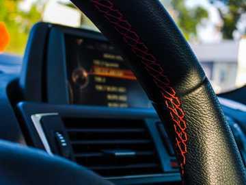 shallow focus photography of car air vent - Mazda 3 Starting wheel with red stitching. 10620 Fairfax Blvd, Fairfax, VA 22030, USA, United States