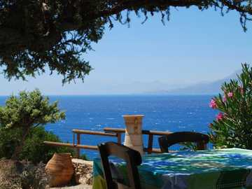 Somewhere on Crete - Tavern under a pine tree with a view to the sea