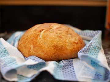 bread on white and blue textile - Homemade bread. One of the upsides to the lockdown. .