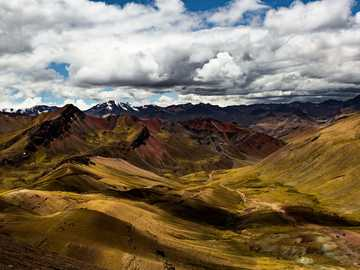 rocky mountain under cloudy blue sky during daytime - I actually find the surroundings of Rainbow Mountain much better. Rainbow Mountain, Cusco, Peru