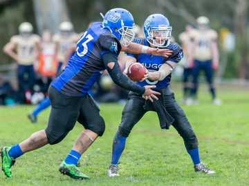 Gridiron Victoria - Melbourne Uni Royals - time-lapse photography of men playing football in field. Brens Drive, Parkville VIC, Australia