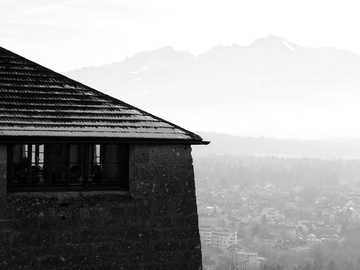 Eat with a view - grayscale photo of brick house near mountain. Salzburg, Austria