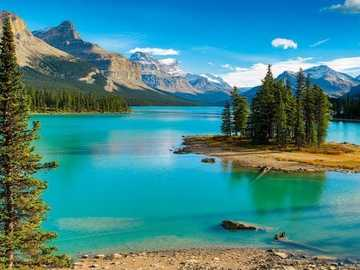 Lake Surrounded By Forest And Mountains. Canada - Lake Surrounded by Forest and Mountains. Canada