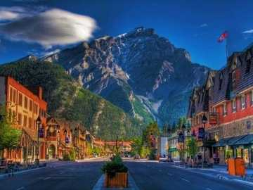 Street And Houses On A Background Of Mountains, Canada - Small town on the background of mountains. Canada